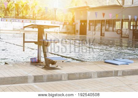 Swiming pool and jumping stand with ray of light