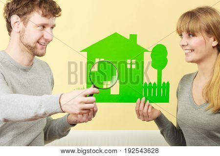 Cheerful Couple With House.