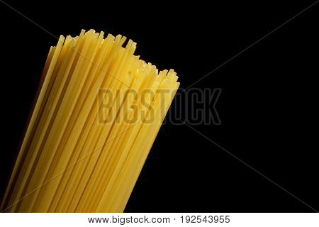 Beam of Italian pasta on a black background