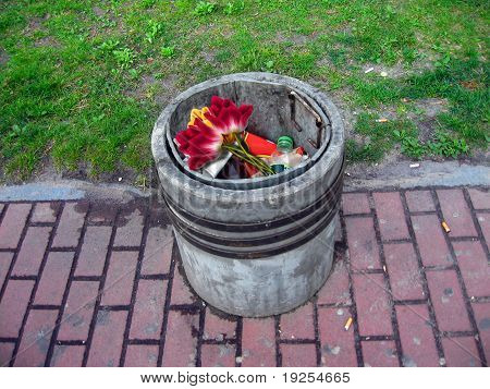 Garbage bin with flowers