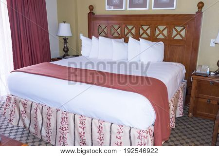 Beautiful Elevated King Sized Bed with Pillows