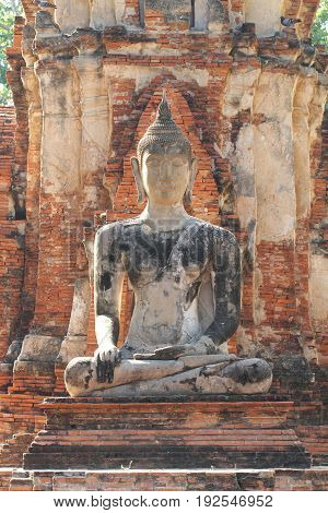 400 years old of sitting ancient buddha statue, one of the most important landmark at ayutthaya, Thailand