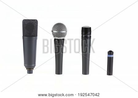 Four Professional Microphones On Isolated White Background