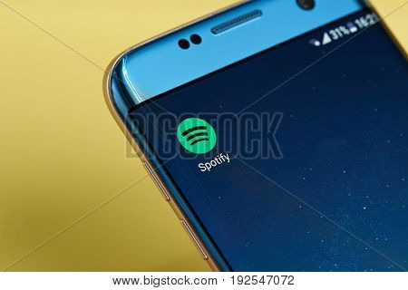 New york, USA - June 23, 2017: Spotify application icon on smartphone screen close-up. Spotify app icon with copy space on screen
