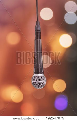 Dynamic microphone with defocused background. Mic. Front view