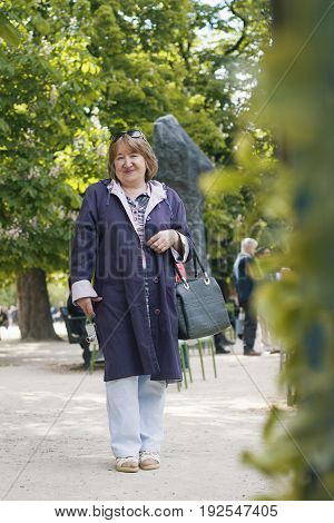 Adult woman walks in the park, outdoor