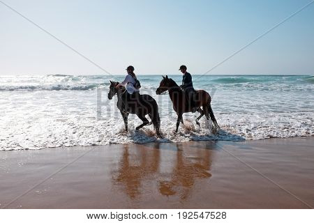 Horse riding in the water from the atlantic ocean