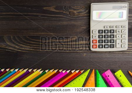 School supplies (pencil pen ruler triangle) on blackboard background ready for your design .school supplies top view .