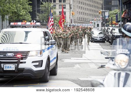 Military Freedom Run: U.S. Marine Corps personnel run down Liberty St with a NYPD escort to the National September 11 Memorial site. Fleet Week, NEW YORK MAY 26 2017