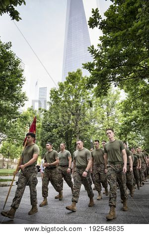 Military Freedom Run: U.S. Marine Corps personnel walk through the National September 11 Memorial site after the Freedom Run. Fleet Week, NEW YORK MAY 26 2017