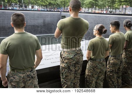 Military Freedom Run: U.S. Marines look to the reflecting pool of the World Trade Center Towers site after the Freedom Run to the National September 11 Memorial site. Fleet Week, NEW YORK MAY 26 2017