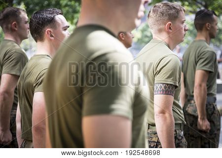Military Freedom Run: Clenched fists of U.S. Marine Corps personnel standing at attention after the Freedom Run to the National September 11 Memorial site. Fleet Week, NEW YORK MAY 26 2017