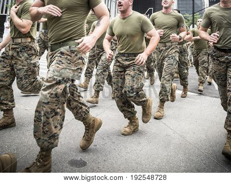Military Freedom Run: U.S. Marine Corps personnel run down Liberty St to the National September 11 Memorial site. Fleet Week, NEW YORK MAY 26 2017