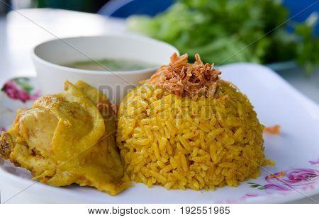 Muslim yellow rice with chicken in restaurant