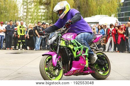 Moto free style pilot stunting on the square - Pyatigorsk Russia Opening of moto season 2015 on 1st May 2015
