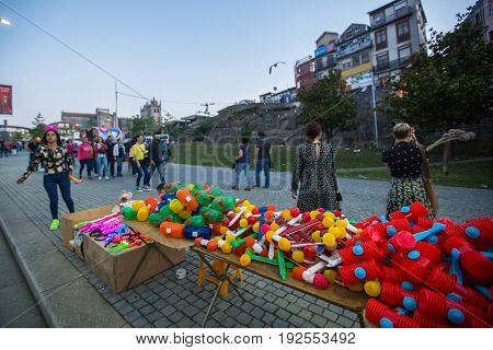 PORTO, PORTUGAL - JUN 24, 2017: During Sao Joao Festival (birth of St.John the Baptist) Very popular holiday is celebrated 23-24 June at midnight, next to the Douro River and Dom Luis I bridge.