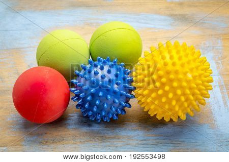 self massage and reflexology therapy concept - a set of small rubber balls