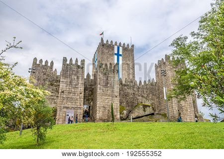 GUIMARAES,PORTUGAL - MAY 14,2017 - View at the Guimaraes castle in Portugal. The city was settled in the 9th century at which time it was called Vimaranes.
