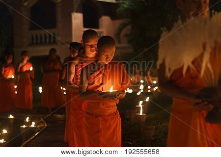 CHIANG MAI THAILAND - FEBUARY 22 : Magha puja day is the important incidents Buddhist day. Buddhist monk walking to pray in the chaple. Feb 22 2016 in Phan Tao .Temple Chiangmai Thailand.