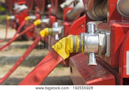 water fire hose on outlet with truck.