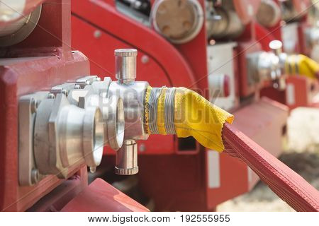 water fire hose on outlet with truck