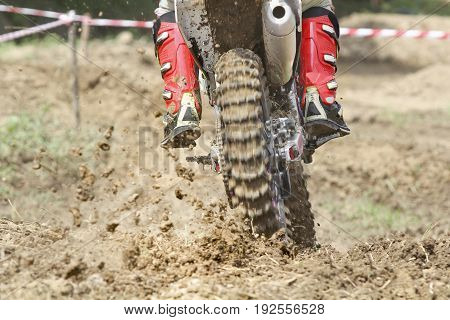 Enduro motorcross racer incress speed on the track