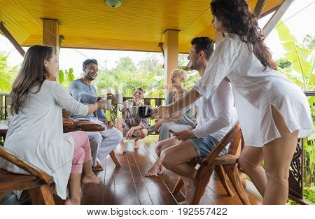 Young People Group Having Breakfast On Terrace Tropical Hotel, Friends Tropic Holiday Vacation Green Forest