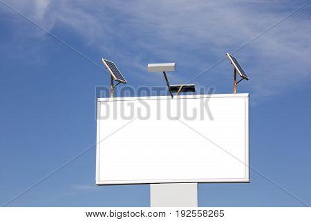 Blank billboard against blue sky Solar panels Vertical