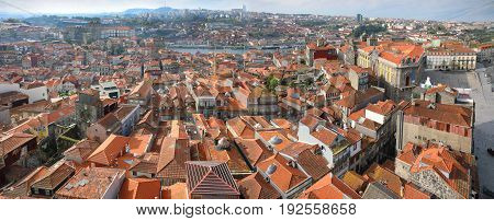 Panoramic view of the roofs of old Porto city from bird eye view at sunny summer day Portugal.