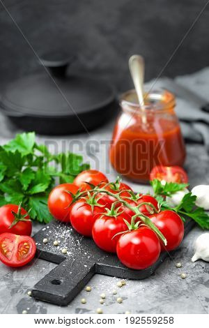 Tomatoes and tomato sauce in jar close up
