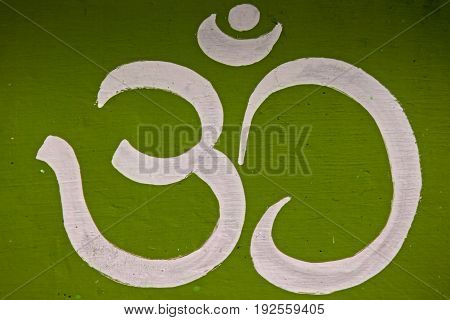 Om Holy Symbol, painted on wall of a temple