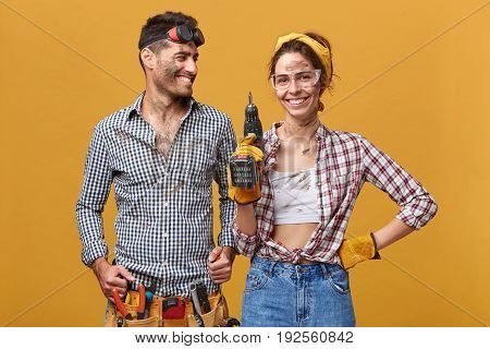 People, Occupation, Job, Profession And Relationships. Two Young Mechanics With Dirty Faces Enjoying