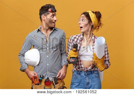 Repair, Maintenance And Remodeling Concept. Dirty Repairman Or Construction Worker With Helmet Worki