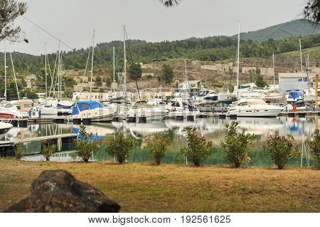 Yachts anchored at the marina.Sailboat harbor, many moored sail yachts in the sea port, modern water transport,summertime vacation, luxury lifestyle and wealth