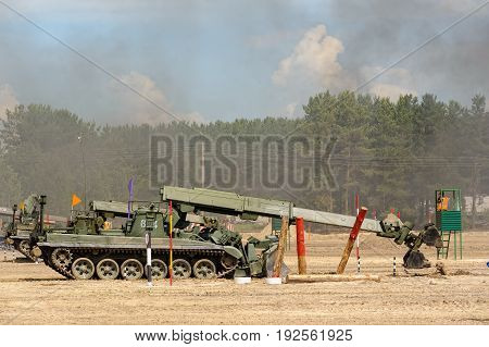 Tyumen, Russia - June 21, 2017: Army Games. Safe Route contest. Recovery of road part for column moving by IMR-2 combat engineer vehicle