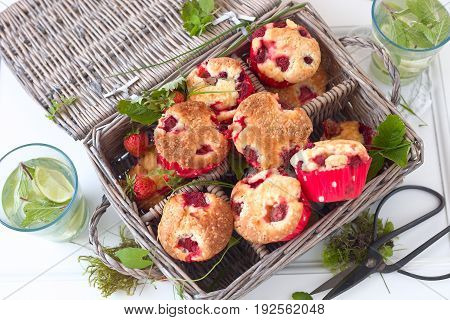 Fresh homemade delicious berry muffins in a picknick basket.