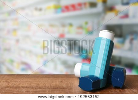 Concept of health care and asthma. Inhalers on counter at pharmacy
