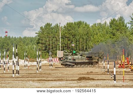Tyumen, Russia - June 21, 2017: Army Games. Safe Route contest. Recovery of road part for column moving by BAT track layer