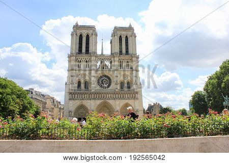 PARIS, FRANCE - JUNE 5, 2017: Notre Dame de Paris, medieval catholic cathedral in Paris, France.  Beautiful view of french gothic architecture, one of the most famous church building in the world.