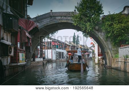 China traditional tourist boats at Shanghai Zhujiajiao town with boat and historic buildings Shanghai China