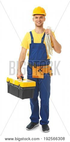 Young smiling electrician with bunch of wires and toolbox on white background