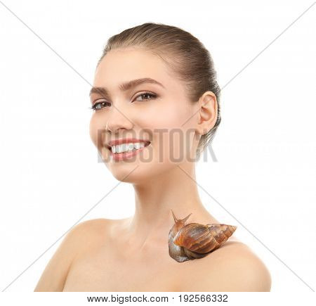 Beautiful young woman with giant Achatina snail on white background