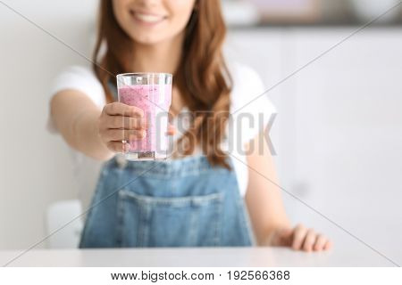 Weight loss concept. Young woman holding glass of healthy delicious smoothie, closeup