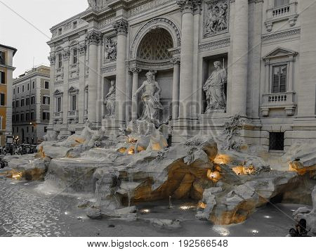ROME ITALY - JUNE 2 2017: Black and color photo with Trevi Fountain the baroque fountain in Rome Italy at dusk. Vintage processing.