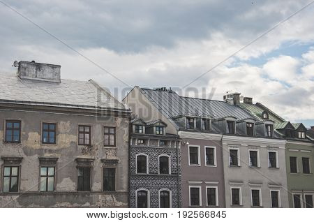 old town tenement houses in line and the sky