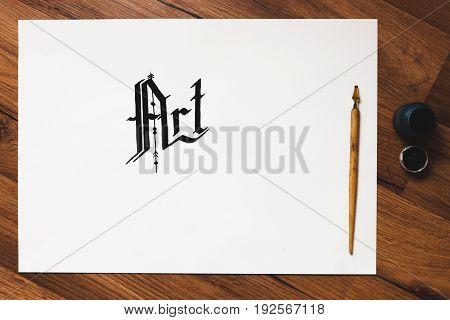 Artist workplace. Ink, handwritten word and pen top view. Painter workshop, business inspiration, creativity, handmade drawing concept