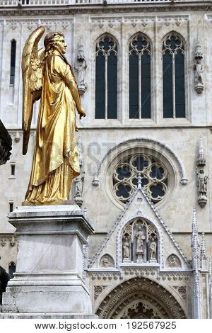 Golden angel statue in front of Zagreb's Cathedral of the Assumption of the Blessed Virgin Mary Zagreb Croatia