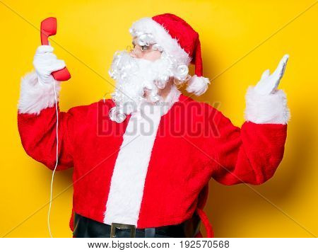Funny Santa Claus Holding Red Handset