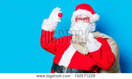 Funny Santa Claus Have A Fun With Light Bulb
