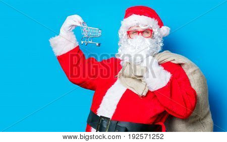 Funny Santa Claus Have A Fun With Shopping Cart